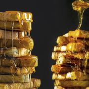 Stacks of toast with lots of honey Stock Photos