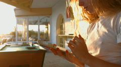 Girl with a tablet in the morning on the veranda. 4K 30fps ProRes (HQ) Stock Footage