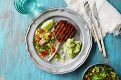 Grilled pork chop with salad and guacamole (Mexico) Stock Photos