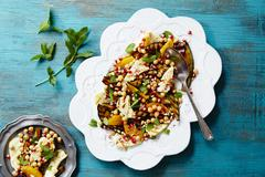 Chickpea salad with haloumi and mint (seen from above) Stock Photos