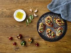 Bruschetta with kumato tomatoes Stock Photos