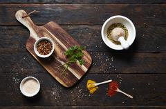 Various spices and fresh parsley Stock Photos