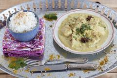 Fish curry with coconut milk, star anise and rice (India) Stock Photos