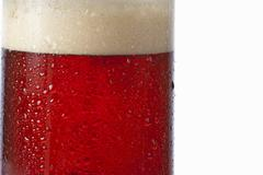 Dark beer in a glass with condensation (detail) Stock Photos