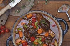 Vegetable stew with leg of lamb and rosemary Stock Photos