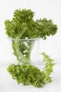 Wasabina leaves (a cabbage for salads and stir-fries, Asia) in a glass and next Stock Photos