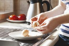 Hard-boiled eggs being shelled Stock Photos