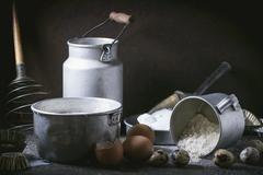 An arrangement of vintage utensils and ingredients for pancakes Stock Photos