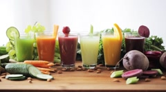 Hand taking glass of vegetable juice from table Stock Footage