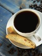 Almond and orange biscotti and a cup of coffee Stock Photos