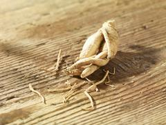 Ginseng on a wooden surface Stock Photos
