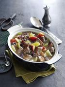 Braised pork with apples, celery, cider and mustard Stock Photos