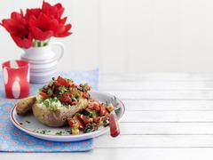 A baked potato filled with ratatouille Stock Photos