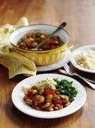 Spanish-style chicken with olives and beans Stock Photos
