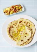 Unleavened bread with Caribbean ackee salt fish Stock Photos