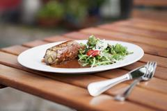 Beef roulade with mustard and a side salad Stock Photos