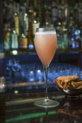 A Bellini served with cheese pastries Stock Photos
