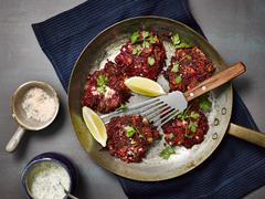 Beetroot and courgettes fritters with tzatziki Stock Photos