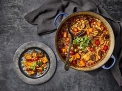 Lamb and pumpkin stew with rice pasta Stock Photos