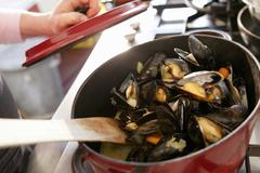 Steamed mussels in a saucepan Stock Photos
