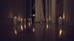 4k Thriller Shot in a Long Hall with Candles, Child walking in with a Chandelier Stock Footage
