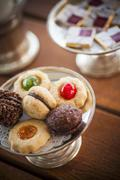 Various mini biscuits on a silver stand with a doily Stock Photos