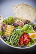 Salad niçoise with grilled unleavened bread Stock Photos