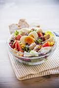 A mixed salad with tuna fish, sweetcorn and hard-boiled egg Stock Photos