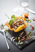 Wholemeal vegetable rice served in a fried pastry bowl Stock Photos