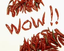 The word 'Wow!!' spelt using dried, red chilli peppers Stock Photos