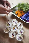 Poached oysters in coconut milk garnished with edible flowers Stock Photos