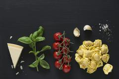 Ingredients for tortellini with tomato sauce Stock Photos