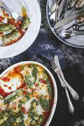 Ricotta dumplings with spinach in tomato sauce Stock Photos
