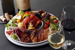 An appetiser platter served with wine Stock Photos