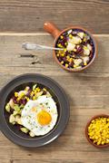 Potato salad with kidney beans, sweetcorn, avocado and fried egg Stock Photos