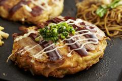 Okonomiyaki with noodles (Japan) Stock Photos