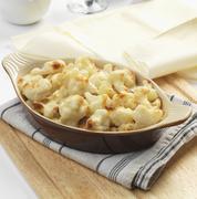 Cauliflower gratin with cheese Stock Photos