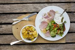 Sauerfleisch (spiced pork dish from Schleswig-Holstein) with remoulade and fried Stock Photos