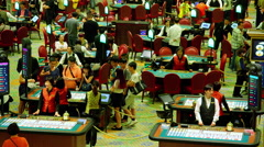 BLACK JACK POKER TABLES VENENTIAN CASINO MACAU Stock Footage