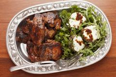 Chicken with a fig and balsamic glaze with a rocket and feta cheese salad Stock Photos