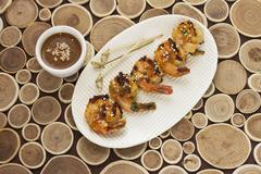 Shrimps with orange glaze and a dip Stock Photos