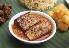 Nyonya cuisine: aubergines in a curry and coconut sauce (Malaysia) Stock Photos