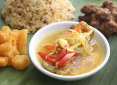 Nyonya cuisine: grouper fillet in a tamarind sauce (Malaysia) Stock Photos