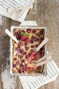 Clafouti with raspberries Stock Photos
