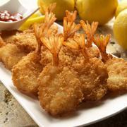 Breaded fried prawns with lemons Stock Photos