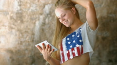Teen Girl is Using Tablet PC at morning. Casual Lifestyle. 4K 30fps ProRes (HQ) Stock Footage