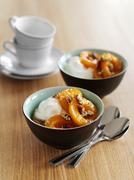 Quark with poached apricots, pecan nuts and maple syrup Stock Photos