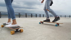 Young people ride long boards Stock Footage