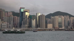 Hong kong ferry in the bay at sunset Stock Footage