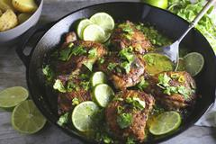 Chicken thighs with lime Stock Photos